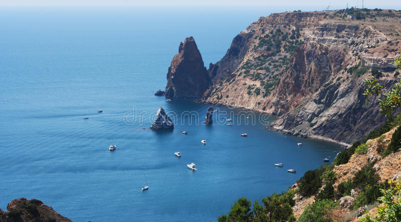 Cape with mountains and blue sea royalty free stock photo