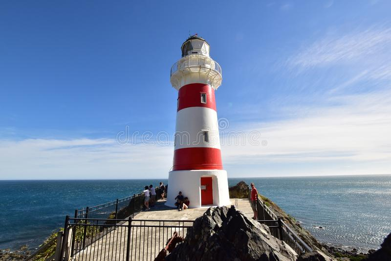 Beautiful colorful lighthouse in Cape Palliser New Zealand royalty free stock images
