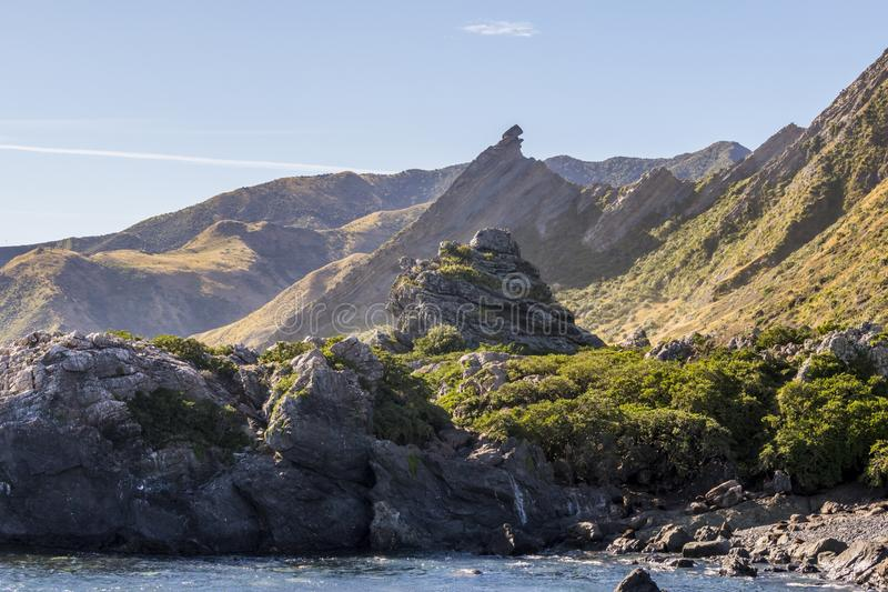 Sharp peaks of the Cape Palliser mountains in New Zealand stock image