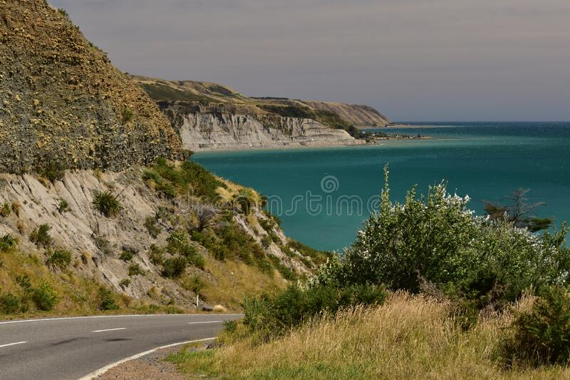 Cape Palliser road view landscape with the blue sea nd cliffs royalty free stock images