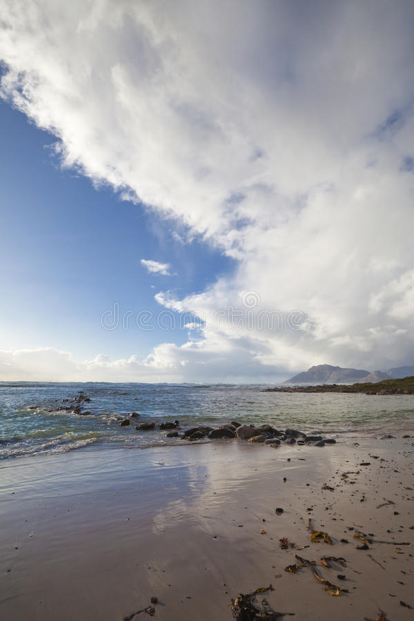 Cape Point seascape, South Africa. Coastal landscape of the Cape peninsula. South of Cape Town at Kommetjie with clouds from the end of a storm front stock photo