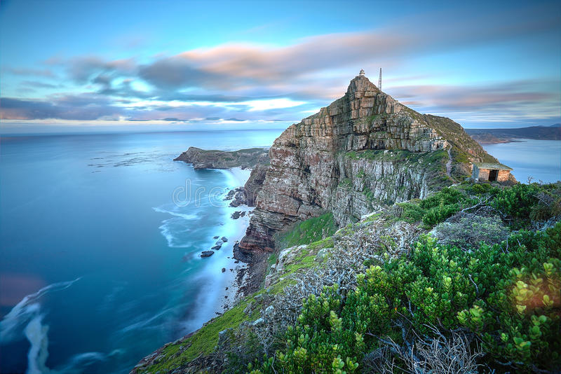 Cape Point South Africa. Cape Point, South Africa as time stands still - slight movement in the water and clouds as the sun rises in the back. There's a stock image