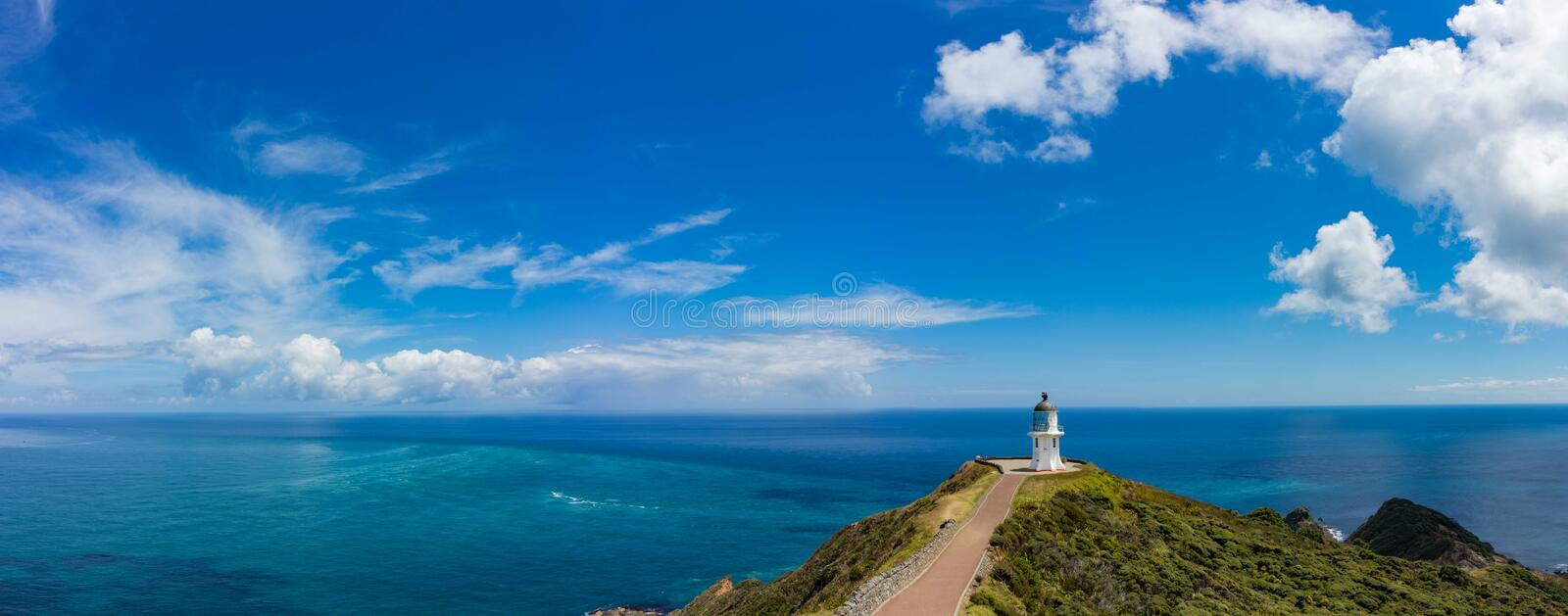 Cape Reinga offers the ultimate northern New Zealand experience. See two oceans collide and discover the place of leaping, where Maori spirits begin their royalty free stock image
