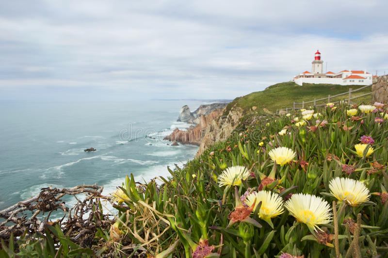 Cape Roca. Portugal. Landscape with flowers. The westernmost point of Europe. vertical royalty free stock photos
