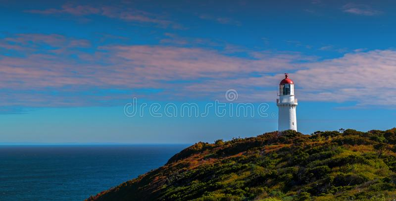 Cape Schanck lighthouse under the purple clouds royalty free stock photo
