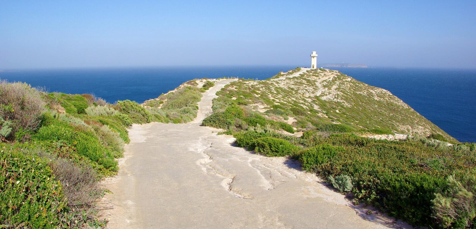 Cape Spencer Lighthouse. Undulating dirt track along a heather covered ridge leading to the Cape Spencer Lighthouse. Innes National Park; Yorke Peninsula; South stock photography
