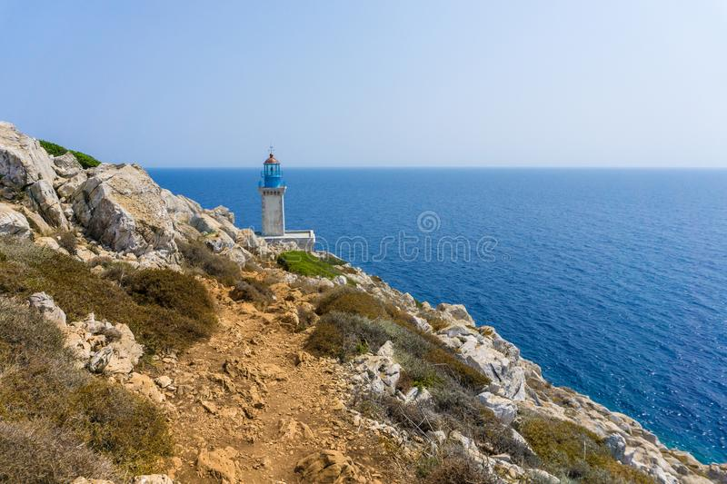 Lighthouse at cape Tainaron lighthouse in Mani Greece. Cape Tenaro, Cape Matapan is the southernmost point of mainland Greece. Situated at the end of Mani, in royalty free stock photography