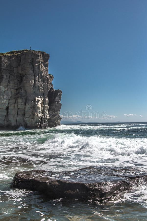 Cape Tomisina. far East. Nature, element, rocks. waves. heaven and sea. clouds at Cape.   horizon. nature of Russia stock image
