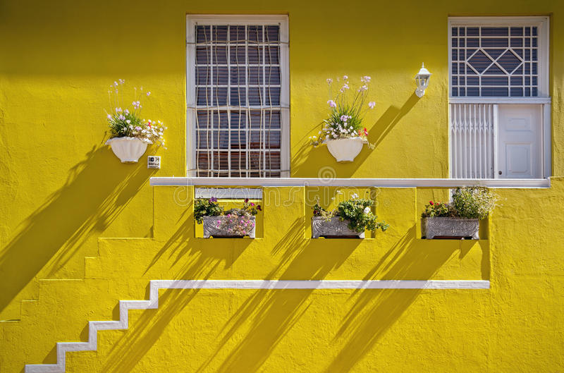 Cape Town, South Africa - Brightly painted house in Bo Kaap, Cap. Cape Town, South Africa - Yellow painted house in Muslim Bo Kaap quarter of Cape Town royalty free stock images