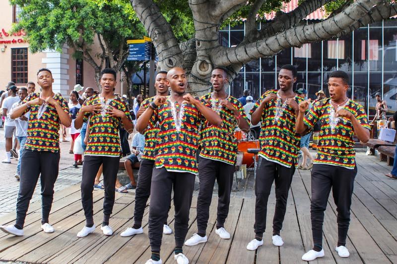 CAPE TOWN, SOUTH AFRICA - DECEMBER 23, 2017: group of young men in national african costumes dancing and singing presenting their royalty free stock photos