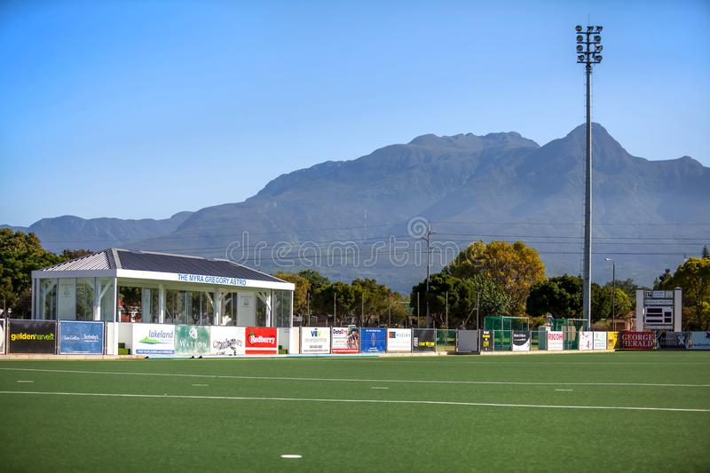 Hockey field with artificial grass playing surface. stock photography