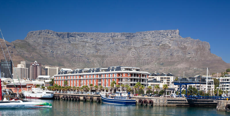 Cape Town waterfront and table Mountain. Table Mountain looking down on the Cape Town waterfront royalty free stock photography