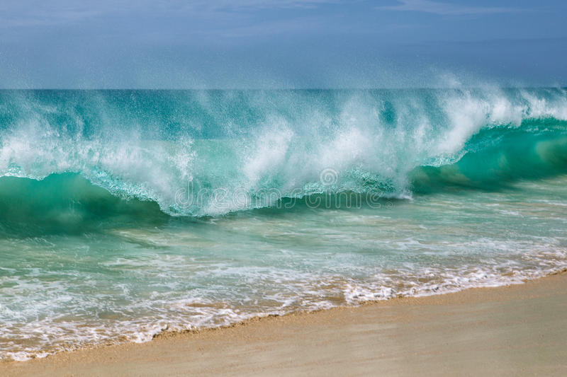 Cape Verde Beach. Ocean waves breaking at Cape Verde sandy beach in summer on a sunny day stock photography
