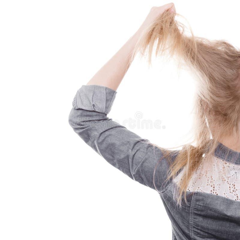 Capelli furiosi di tirata della donna dalla testa immagini stock