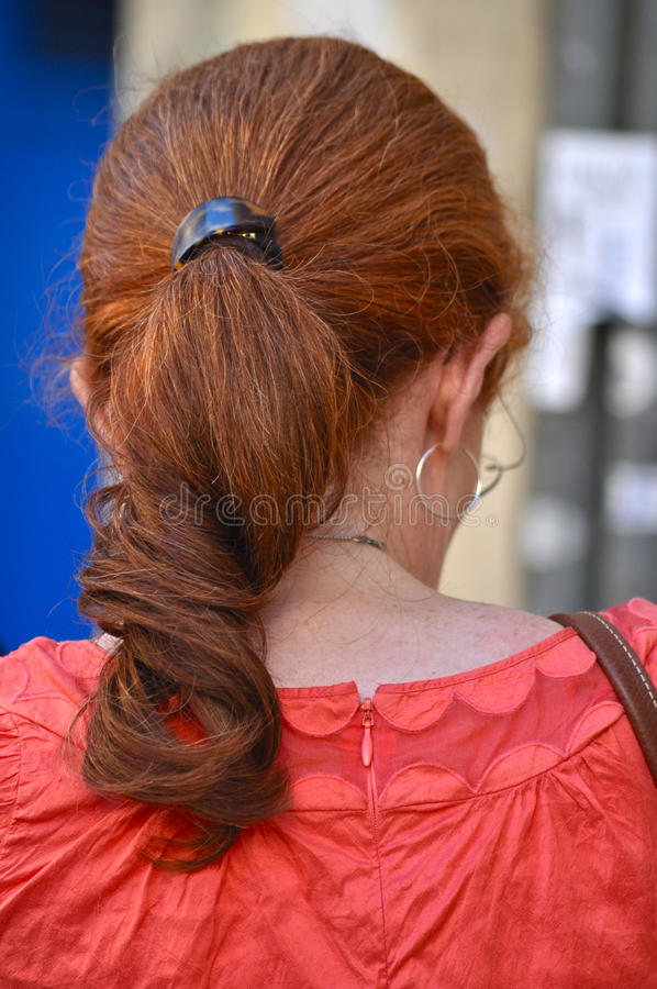Capelli rossi in un Ponytail fotografie stock