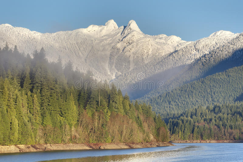 Capilano Reservoir and the Lions, Vancouver, British Columbia stock photos
