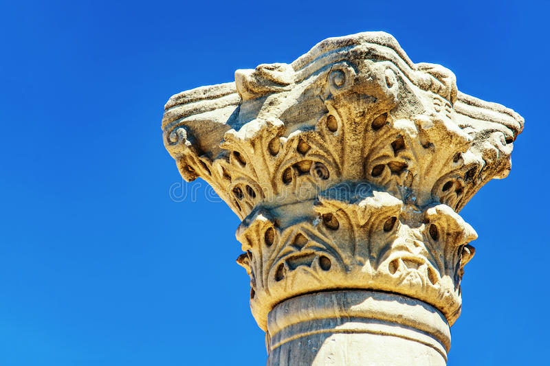 Capital of ancient greek columnus of Chersonese against blue sky. Sevastopol. Ukraine. Capital of ancient greek columnus of Chersonese against blue sky. Close-up royalty free stock photo