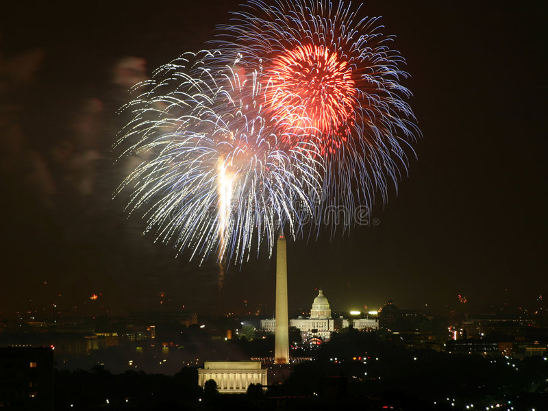 Capital Fireworks. White fireworks explode over the United States Capitol royalty free stock images