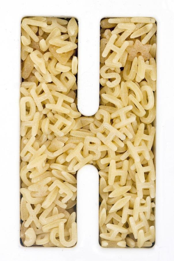 Capital Letter H made up from alphabet pasta. Macro image royalty free stock photos
