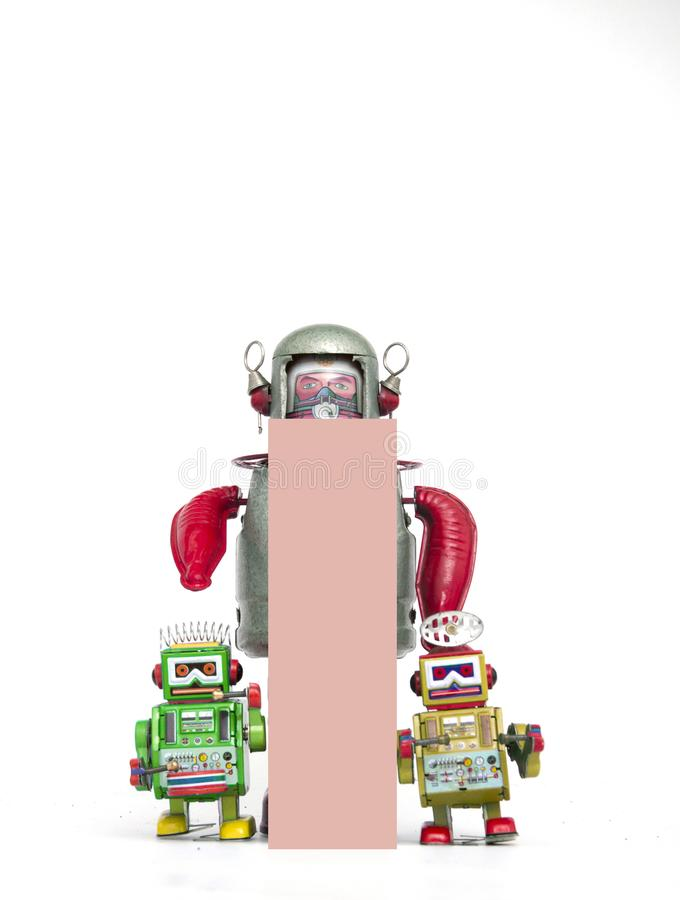 Big letter pink i held by vintage robot toys. Capital letter pink i held by vintage robot toys on white royalty free stock images