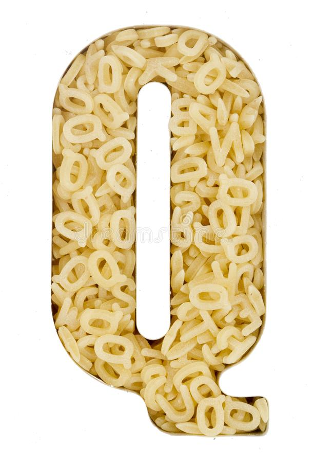 Capital Letter Q made up from alphabet. Pasta macro image royalty free stock image