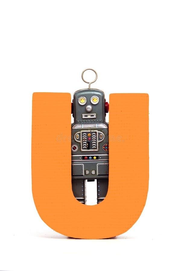 Big letter U vintage robot toys. Capital letter U held by vintage robot toys stock photography