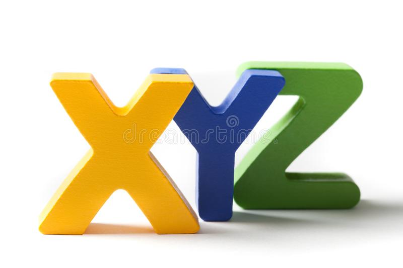 Capital Letters X, Y, And Z. Last three capital letters from the alphabet X,Y and Z, made of wood and isolated on white royalty free stock image