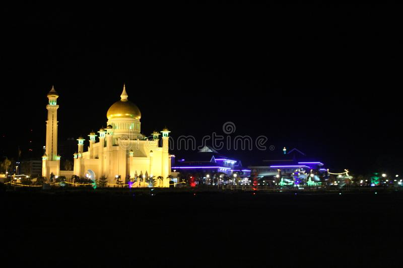 The Capital Mosque In Brunei Darussalam. A night picture of a trademark mosque in Brunei Darussalam and also, the trademark of Brunei`s best shopping mall called stock photo
