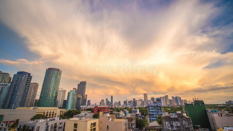The capital of the Philippines is Manila. Makati city. Beautiful sunset with thunderous powerful clouds. stock image