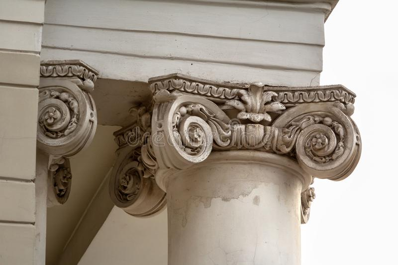 Capital - the upper part of the column close-up. Neoclassical style building element stock photography