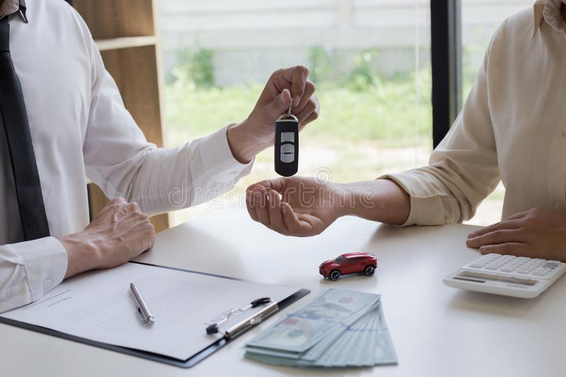 The capitalist has rented a car for the tenant and the tenant has made a deposit as collateral according stock photography