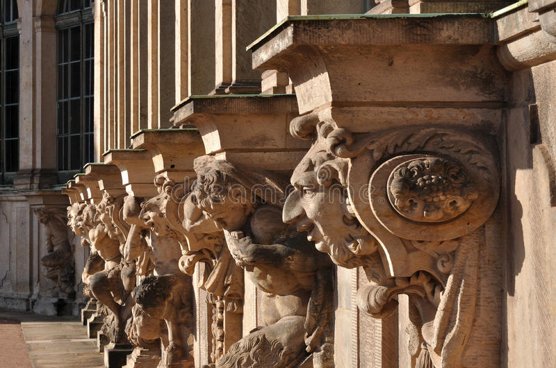 Capitals at zwinger, dresden. Series of grotesque capitals at a famous baroque palace and museum in dresden, the building has been rebuilt after second world war royalty free stock photo
