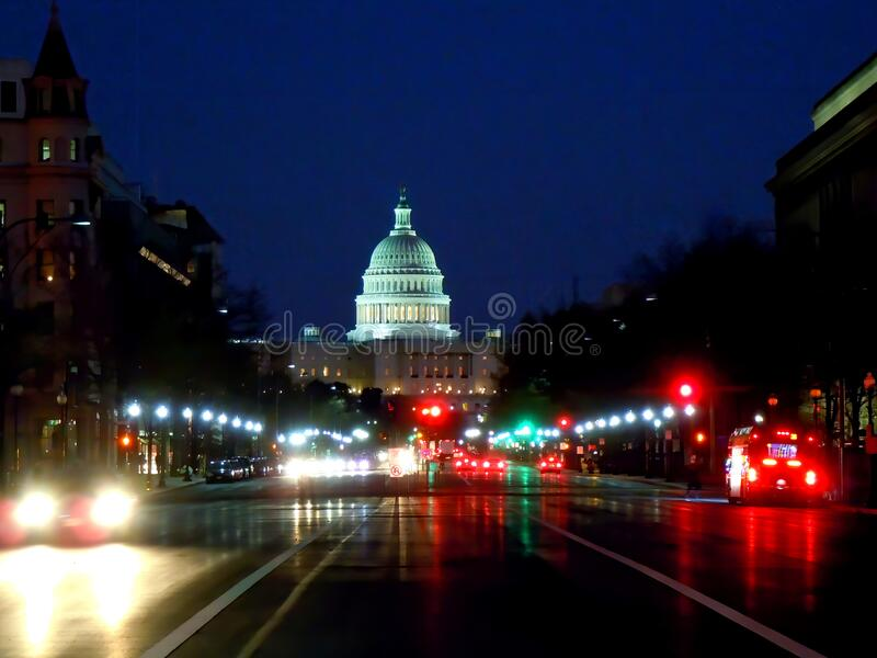 Capitol building and city lights at night. Capitol building and city lights along Pennsylvania Avenue NW in Washington DC, USA at night stock photography