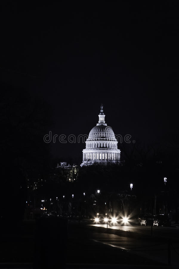 Capitol Dome by Night. WASHINGTON, DC - December 12, 2011: The lit dome of the United States Capitol stands out against a darkened skyline royalty free stock image