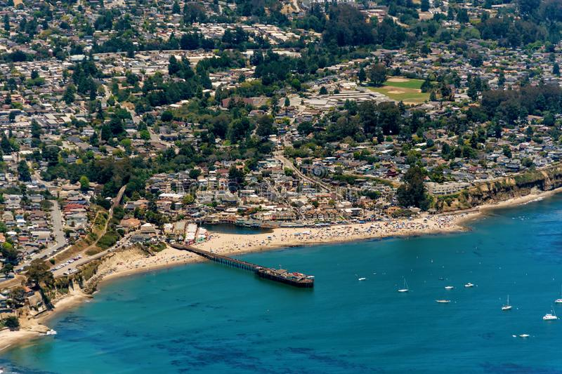 Capitola Beach in California Aerial View. The aerial view of the beach with tourists in the city of Capitola in Northern California, close to the city of Santa royalty free stock images