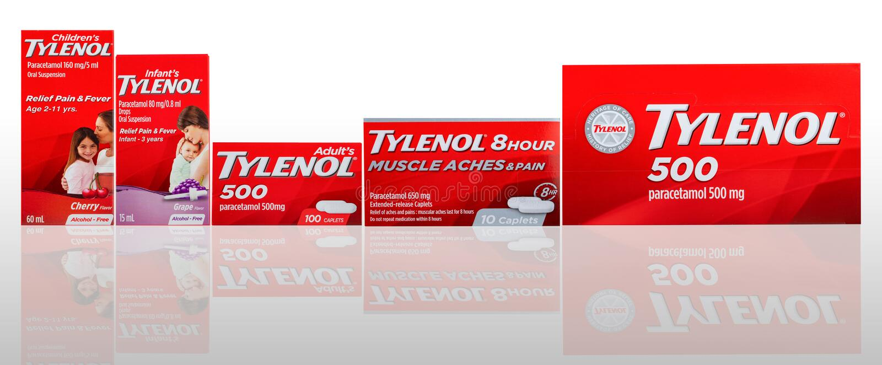 Caplets Tylenol και προφορική αναστολή στην κόκκινη συσκευασία στο υπόβαθρο  στοκ φωτογραφία