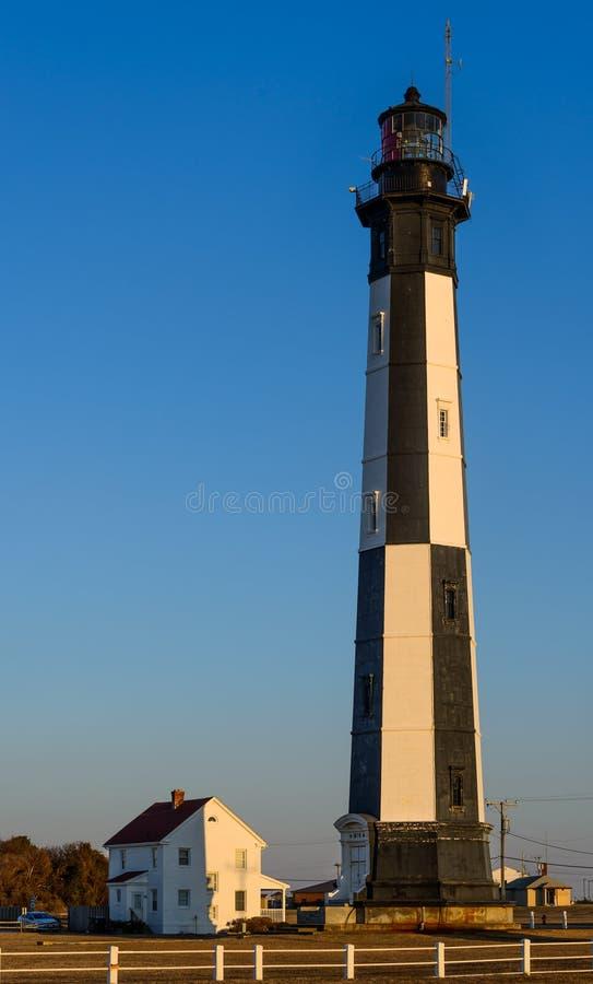 Capo Henry Lighthouse al tramonto fotografia stock