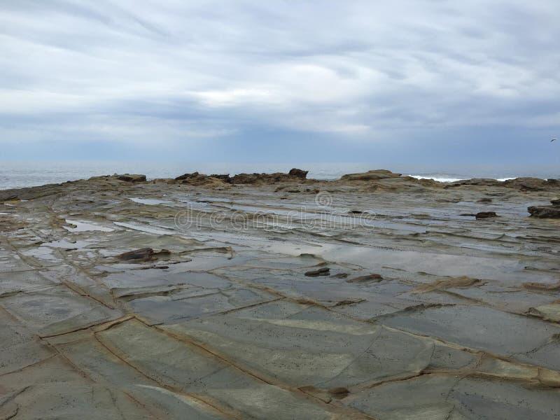 Capo roccioso Patterson del cielo fotografia stock