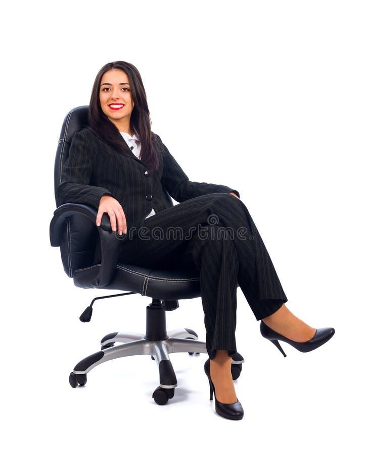 Capo in sedia fotografie stock