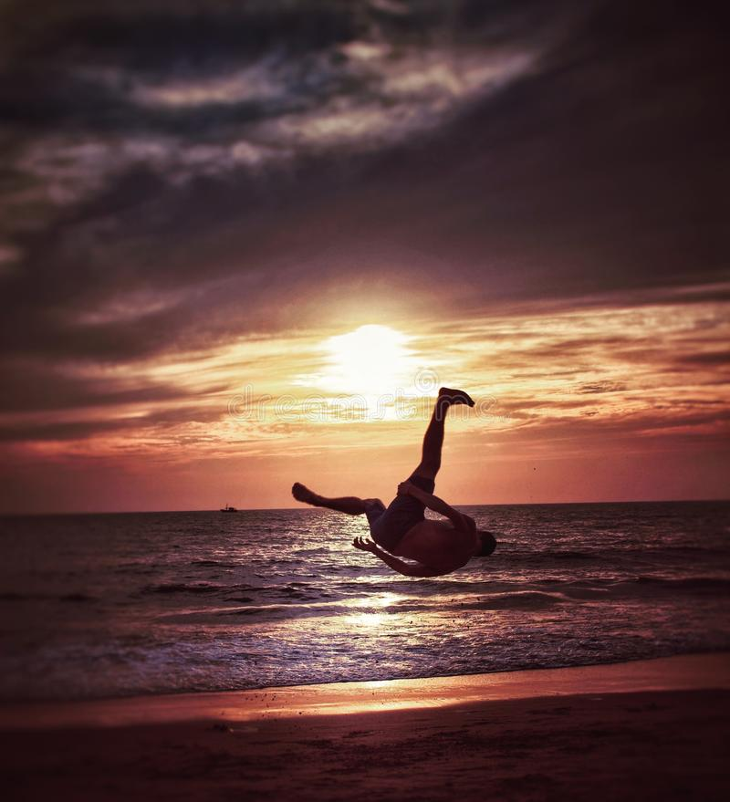 Capoeira on the beach. Capoeira is an Afro-Brazilian martial art that combines elements of dance, acrobatics, and music. It was developed by African slaves in stock photography
