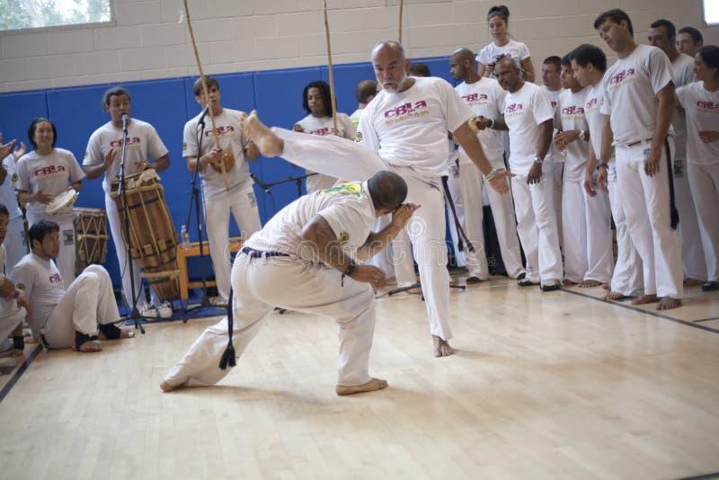 Capoeira Festival. MANHATTAN BEACH, CA - SEPTEMBER 13: Mestres Paulao (R) and Cabeca (L) in the roda or circle at the 11th annual International Capoeira Festival stock photos