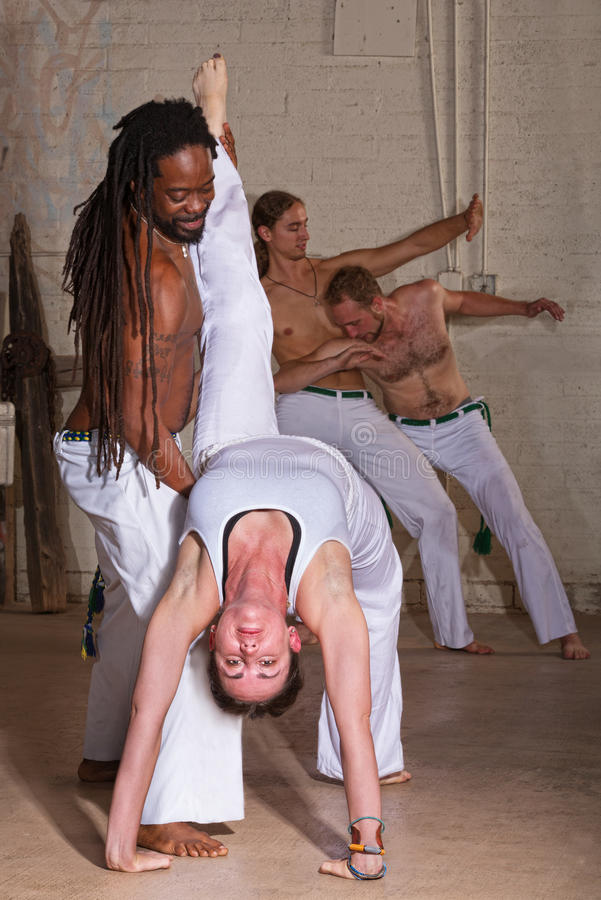 Capoeira Holding Student Backward royalty free stock photos