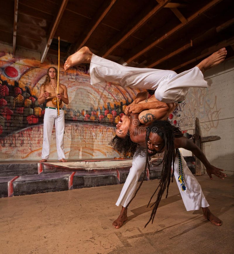 Capoeira Performers Shoulder Throw royalty free stock image
