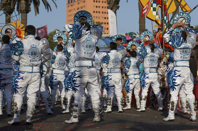 Caporales dance group at the Arica Carnival, Chile. Caporales dance group in ornate costumes performing at the annual Carnaval Andino con la Fuerza del Sol in royalty free stock image