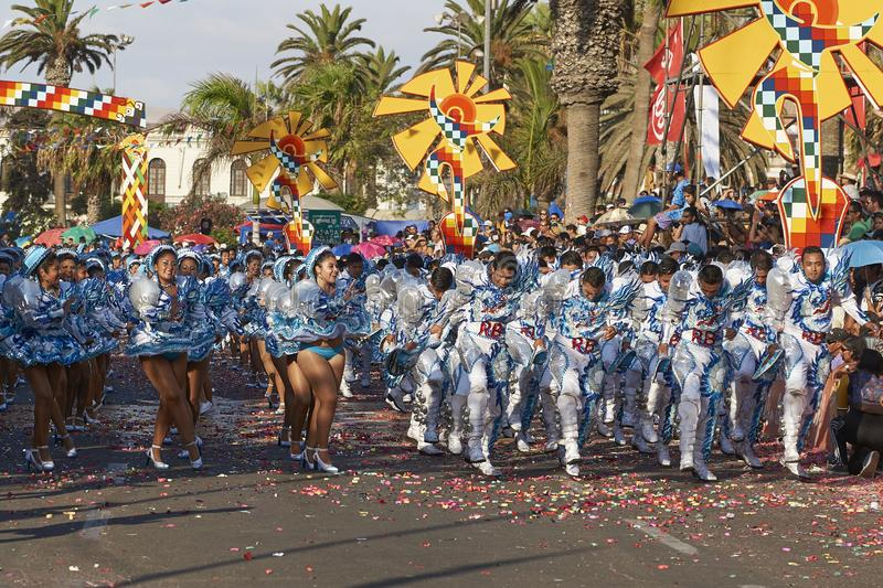 Caporales dance group at the Arica Carnival, Chile. Caporales dance group in ornate costumes performing at the annual Carnaval Andino con la Fuerza del Sol in stock photos