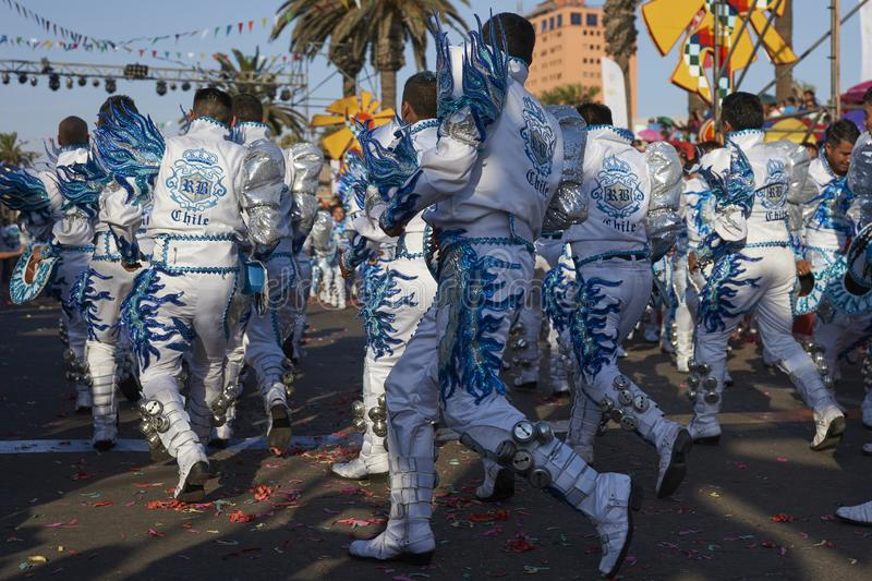 Caporales dance group at the Arica Carnival, Chile. Caporales dance group in ornate costumes performing at the annual Carnaval Andino con la Fuerza del Sol in stock image