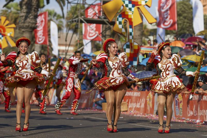 Caporales dance group at the Arica Carnival, Chile. Caporales dance group in ornate costumes performing at the annual Carnaval Andino con la Fuerza del Sol in stock photography