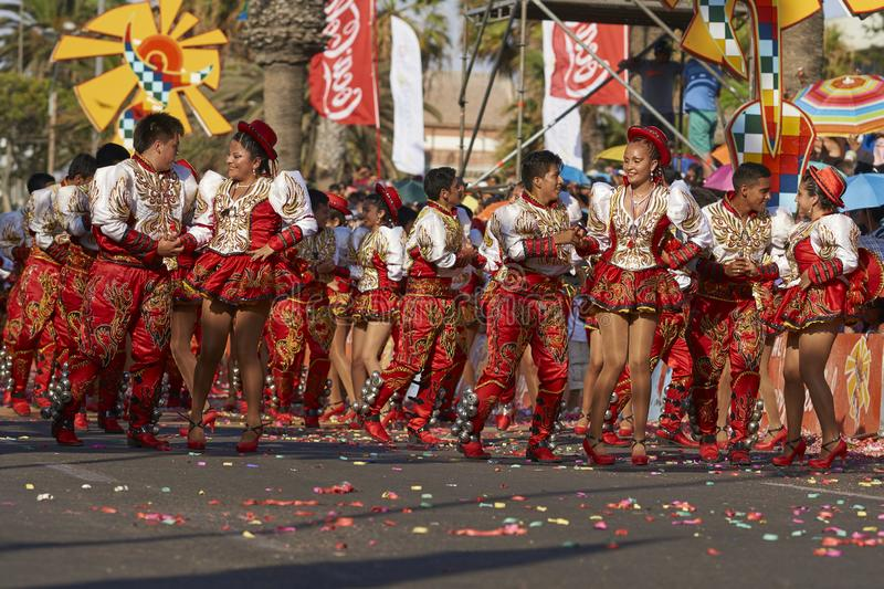 Caporales dance group at the Arica Carnival, Chile. Caporales dance group in ornate costumes performing at the annual Carnaval Andino con la Fuerza del Sol in stock photo