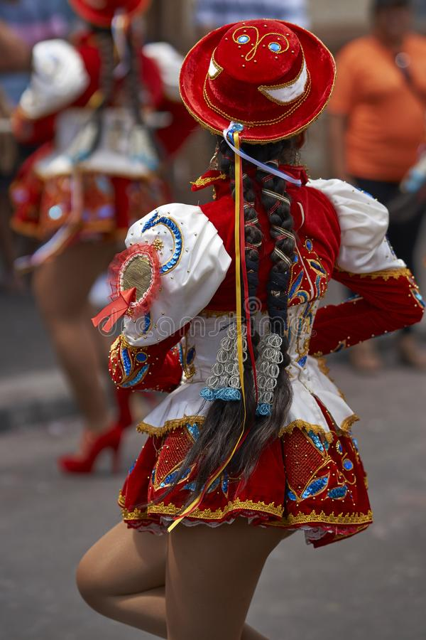 Caporales dancers at the carnival in Arica, Chile. Caporales dancer in ornate red and white costume performing at the annual Carnaval Andino con la Fuerza del stock image