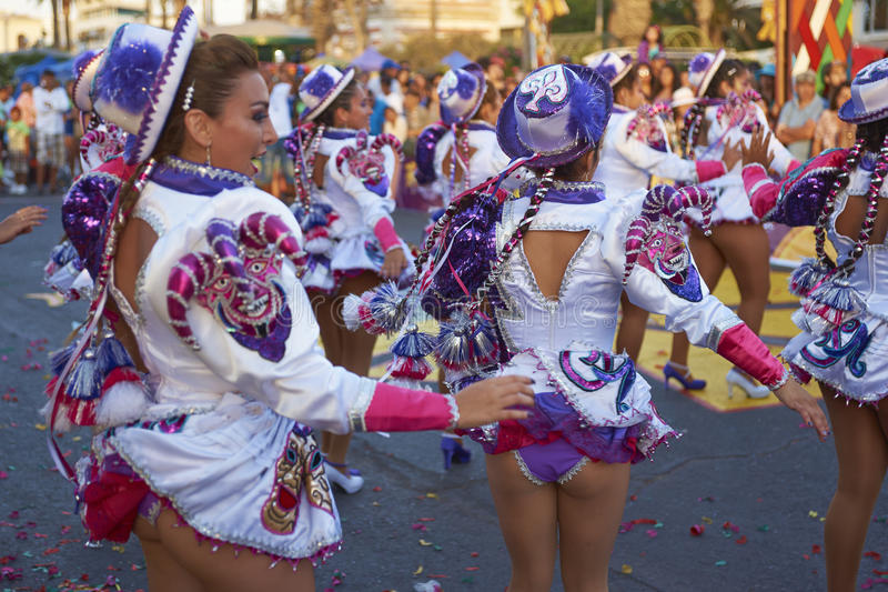 Caporales Dancers at the Arica Carnival, Chile. Female members of a Caporales dance group in ornate costumes performing at the annual Carnaval Andino con la royalty free stock photos